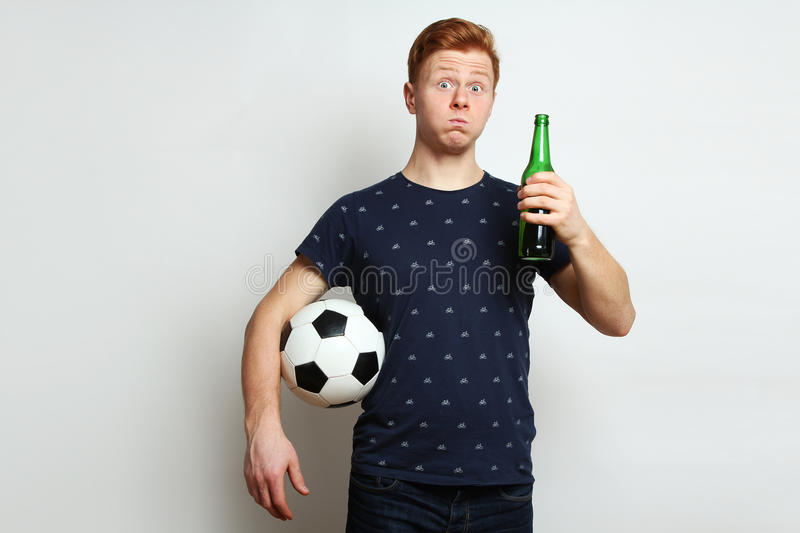 Football fan with beer stock photo