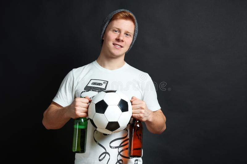 Football fan with beer and ball stock photo