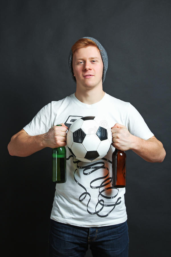 Football fan with beer and ball royalty free stock photo