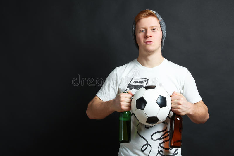 Football fan with beer and ball stock photos