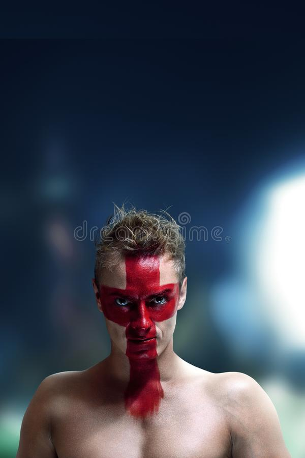 Football fan with England flag painted on his face stock photos