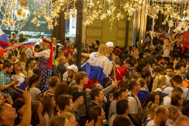 Football fans of different countries celebrate the victory of the Russian team over Spain at Nicholas Street in Moscow royalty free stock photography