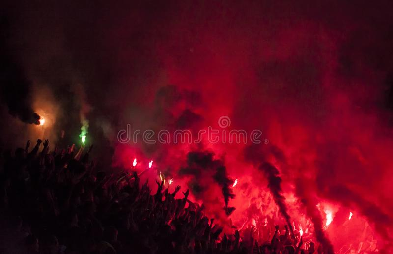 Football fans lit up the lights, flares and smoke bombs. Protest concept stock photography