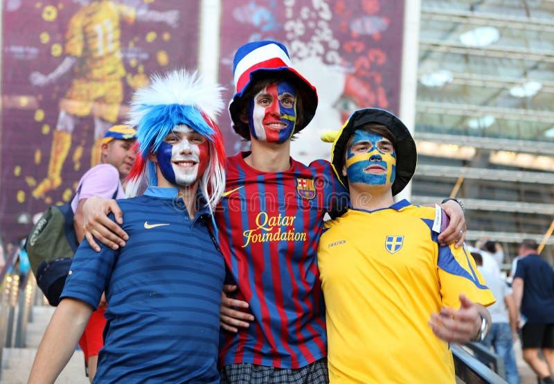 Football fans on Olympic stadium. Ukraine - Kyiv. Olympic stadium, 19.06.2012. Football fans on match Sweden - France, Group D royalty free stock photography