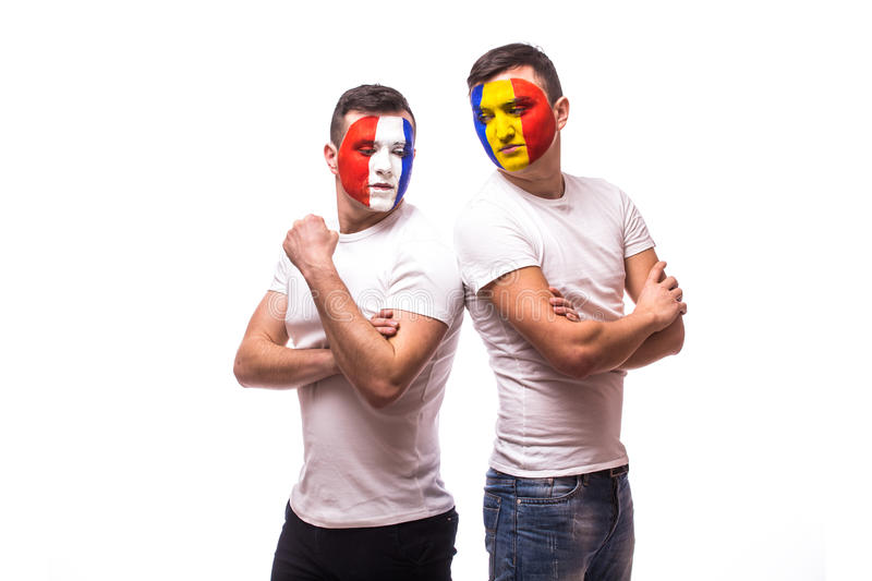 Football fans of Romania and France national teams look each other. France vs Romania. Football fans of Romania and France national teams look each other royalty free stock photo