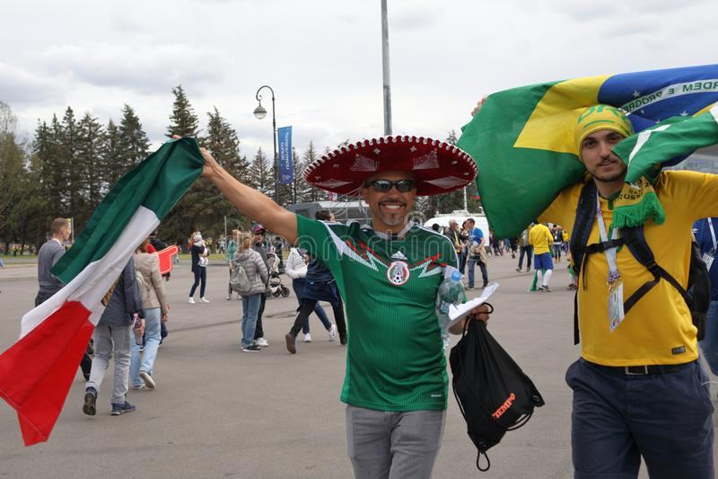 Football fans in Saint Petersburg, Russia during FIFA World Cup 2018. St. Petersburg, Russia - June 22, 2018: Brazilian and Mexican football fans at the Saint royalty free stock photo
