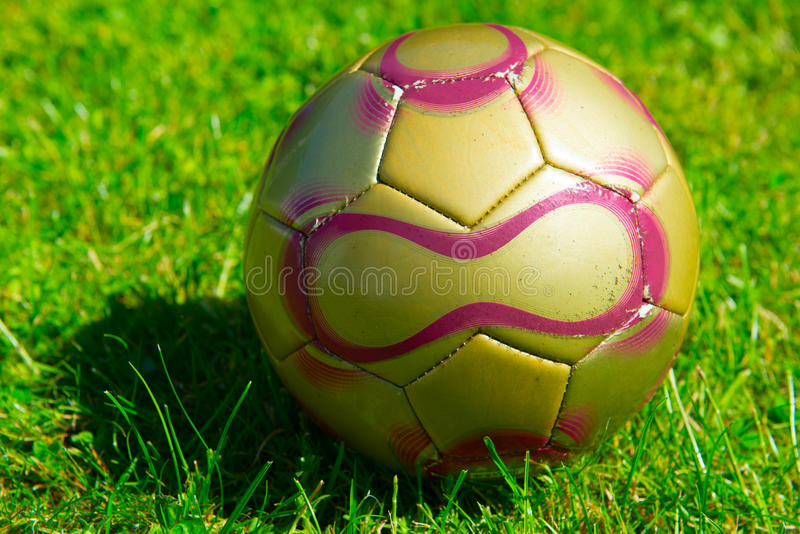 Football on field. Worn football on a lawn stock photography