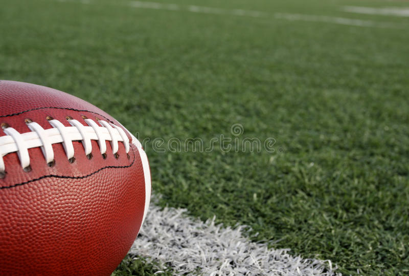 Football with the Field Beyond stock photography