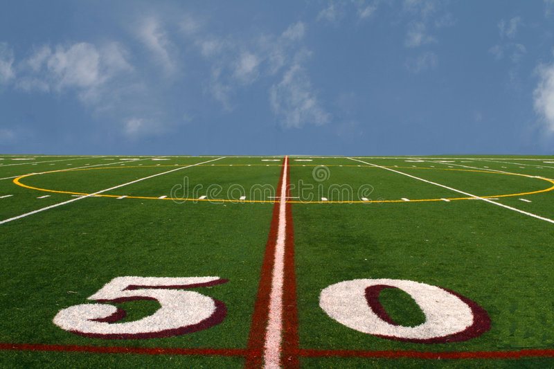 Football field at the edge of the earth royalty free stock images