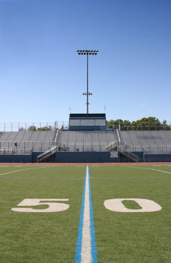Football Field Fifty. Green football field with large yard numbers stock image