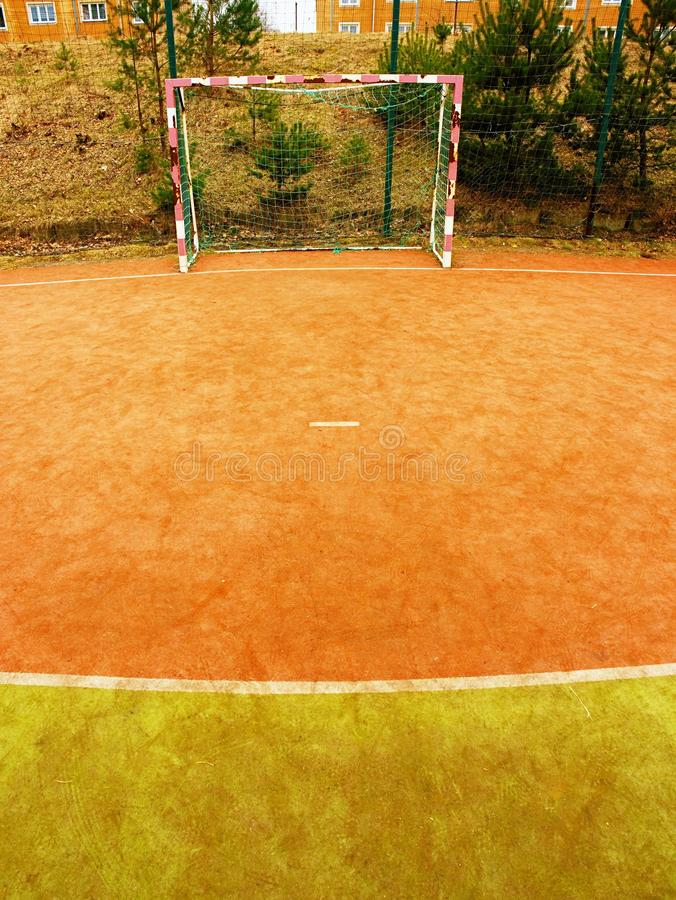 On the football field without goal keeper. Outdoor turf play field. Old playground. At school royalty free stock photos