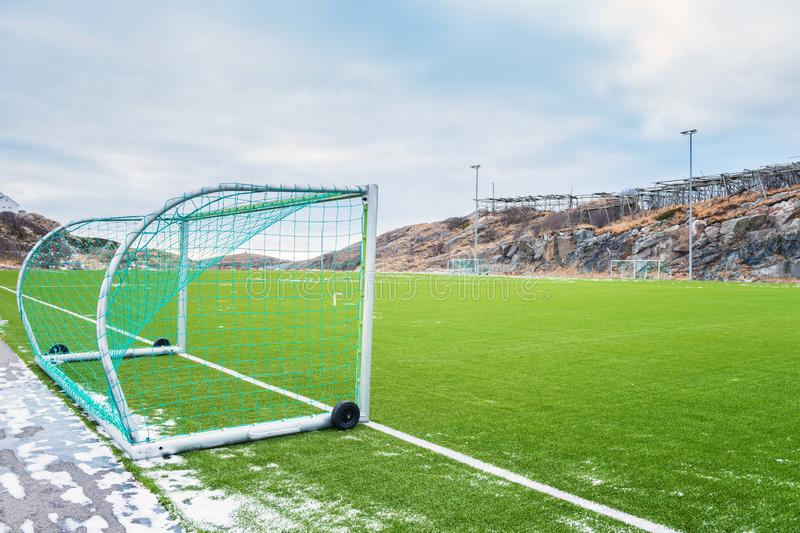 Football field on Lofoten Islands surrounded by rocks, stones and water, Henningsvaer, Norway royalty free stock photos