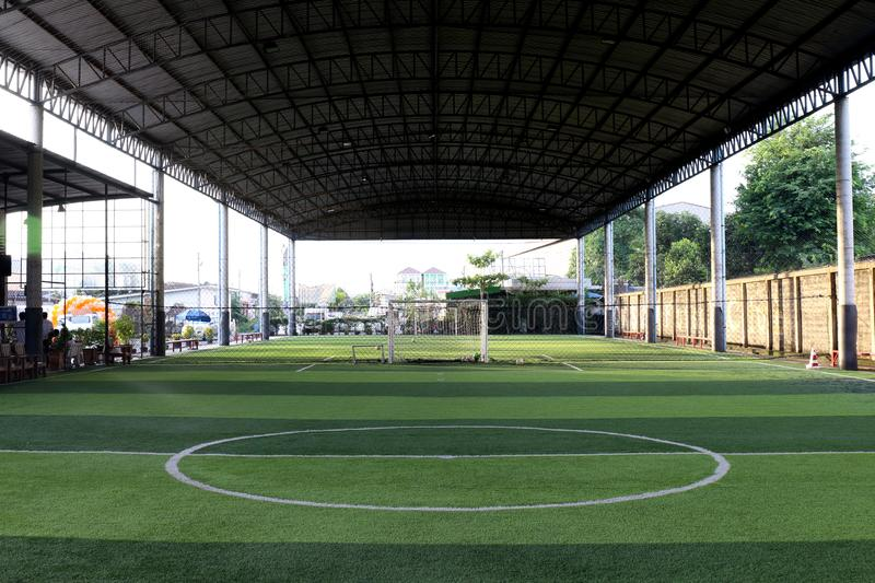 Football field Small, Futsal ball field in the gym indoor, Soccer sport field outdoor park with artificial turf stock photos