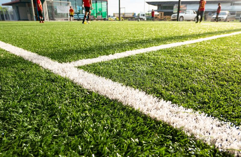Football field ,soccer field , green grass and White line ,White stripe.  stock photo
