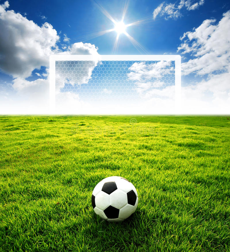 Football field soccer stadium. On the green grass blue sky sport game at background for design royalty free stock images