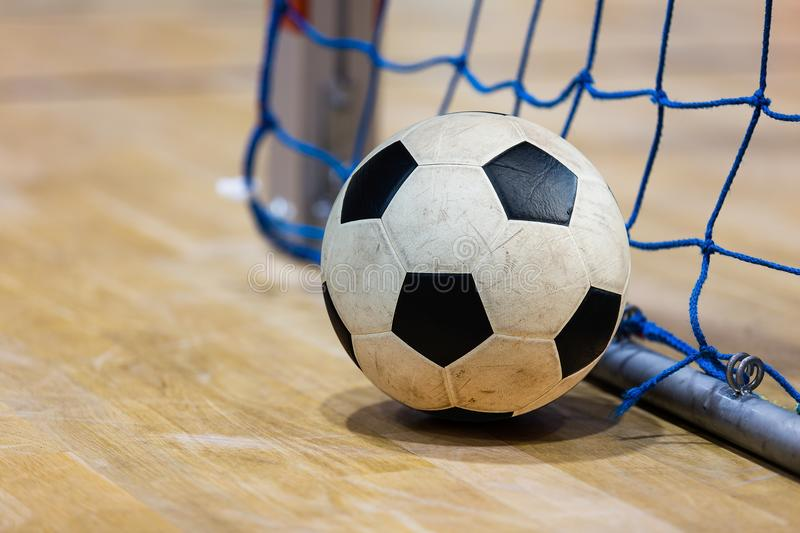 Football futsal ball goal and floor. Indoor soccer sports hall. Sport Futsal background. Indoor Soccer Winter League stock images