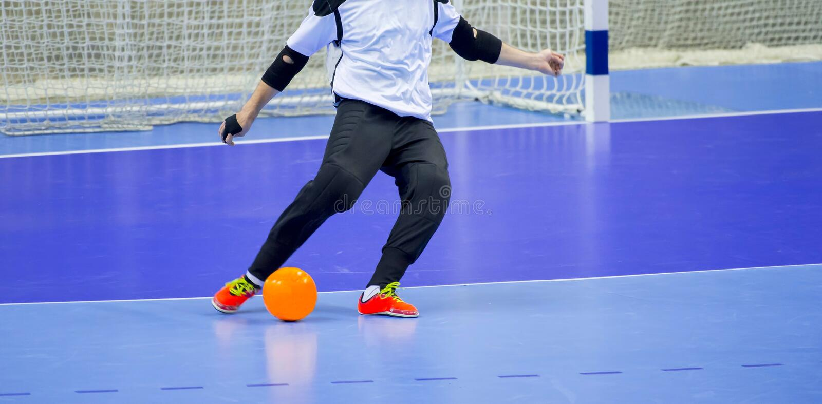 Football Futsal Ball and man Team. Indoor Soccer Sports Hall. goalkeeper with a ball stock images