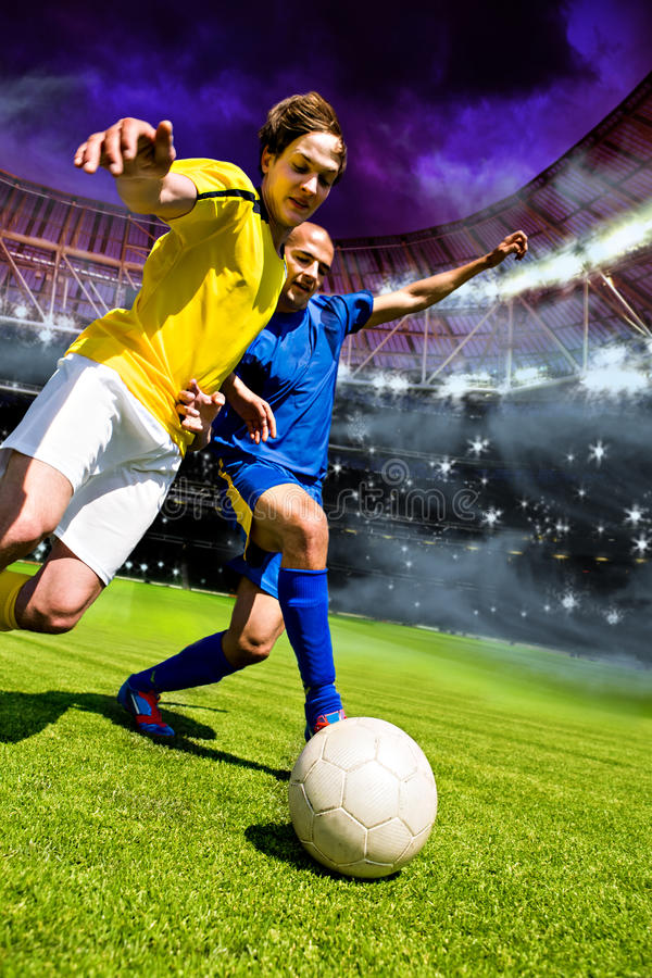 Football game. Two football players from opposing team on the field stock photos