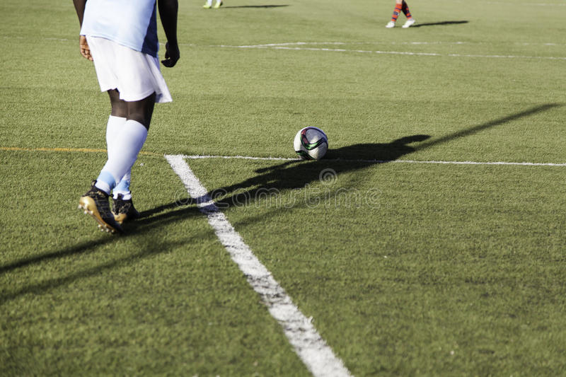 Football game grass. Football match of rival teams on artificial turf, sport royalty free stock photography