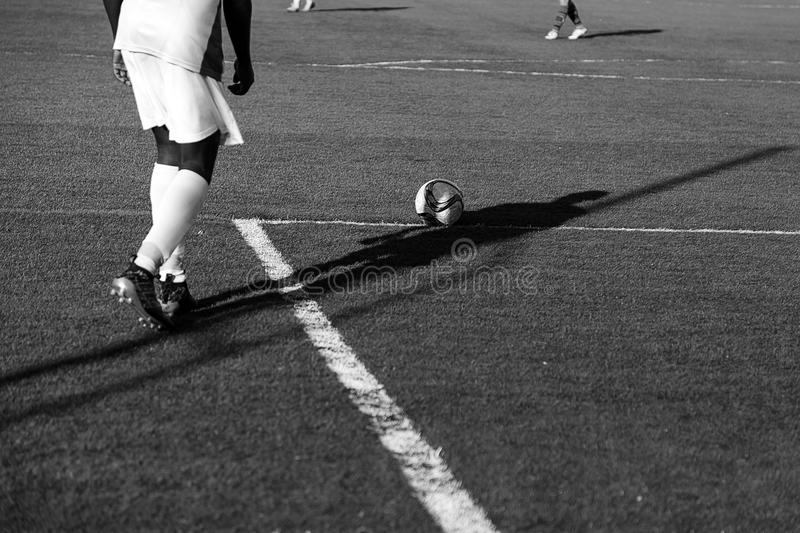 Football game grass. Football match of rival teams on artificial turf, sport stock photography