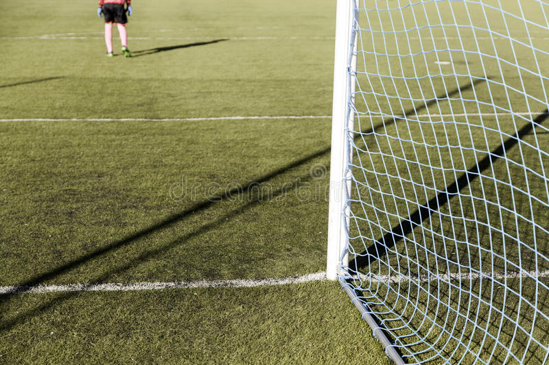 Football game grass. Football match of rival teams on artificial turf, sport royalty free stock photo
