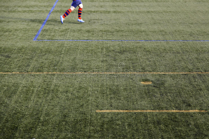 Football game grass. Football match of rival teams on artificial turf, sport stock images