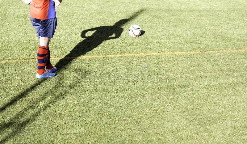 Football game grass. Football match of rival teams on artificial turf, sport royalty free stock photos