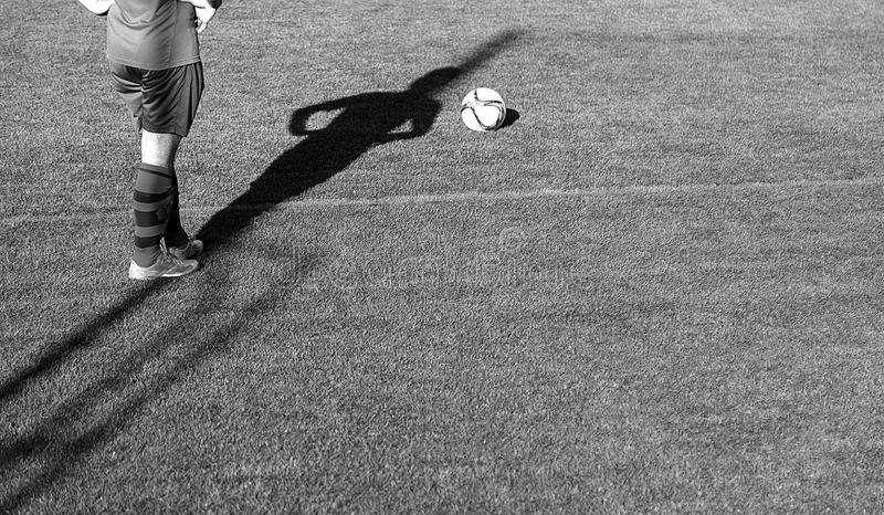 Football game grass. Football match of rival teams on artificial turf, sport stock photos