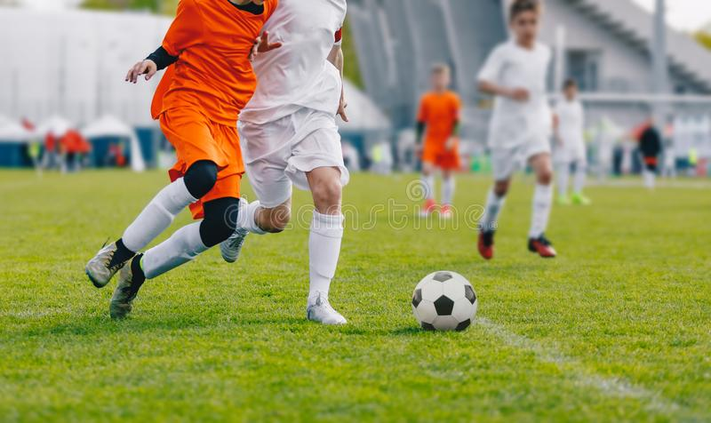 Football Game. Junior Level Boys Kicking Soccer Match on Grass. Youth Football Game. Children Sport Competition. Kids Playing Outdoor stock photo