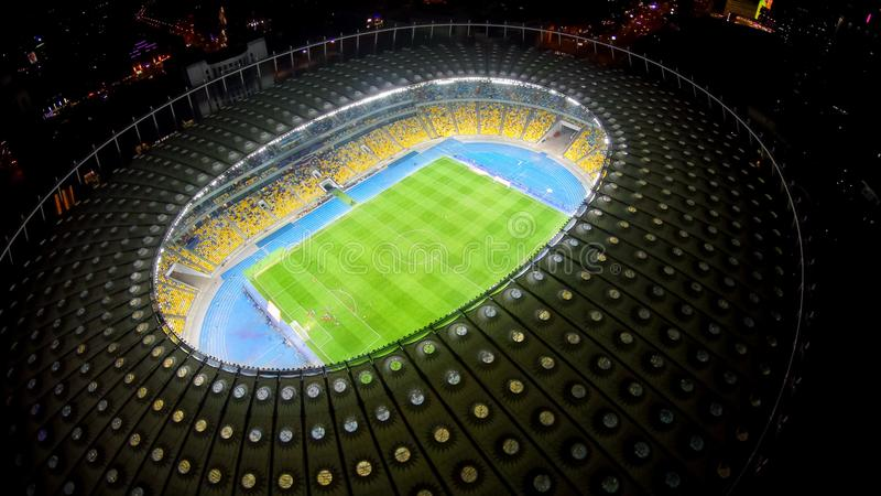 Football game at large stadium, night aerial view of soccer competition, sport royalty free stock images