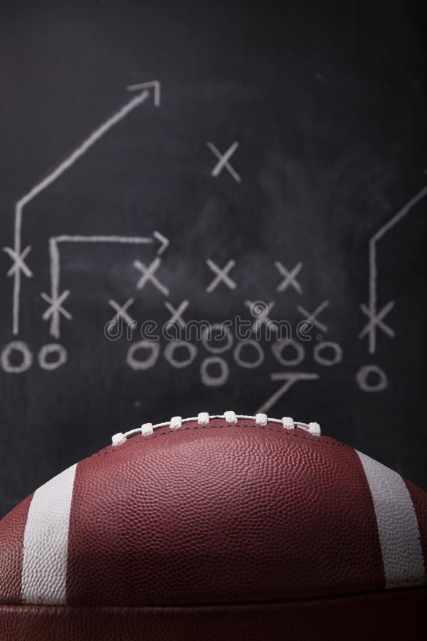 Football Game Plan. An American football and a hand drawn chalkboard play stock photos