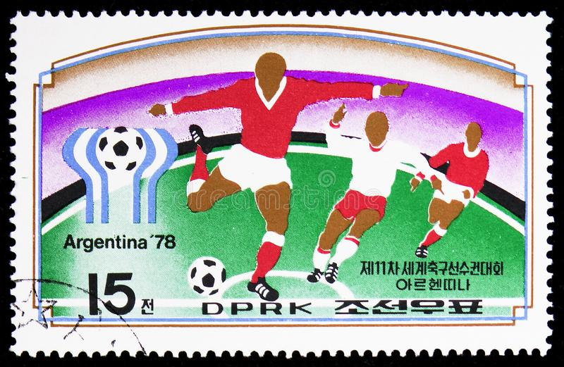 Football game scenes, emblem of the football World Cup 1978 FIFA, Argentina serie, circa 1977. MOSCOW, RUSSIA - FEBRUARY 9, 2019: A stamp printed in Korea shows royalty free stock photo