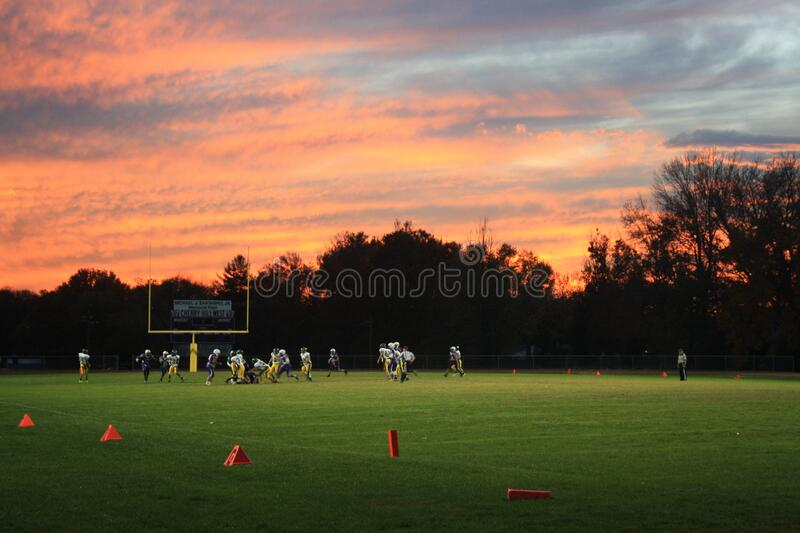 Football game at sunset stock photo
