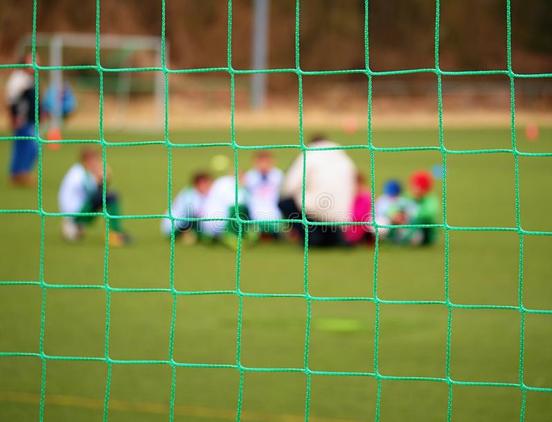 Football gate net. Soccer gate net. In blurry background stand players. royalty free stock images