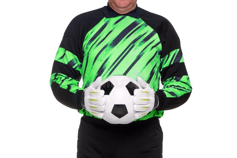 Football goalkeeper holding ball isolated stock image