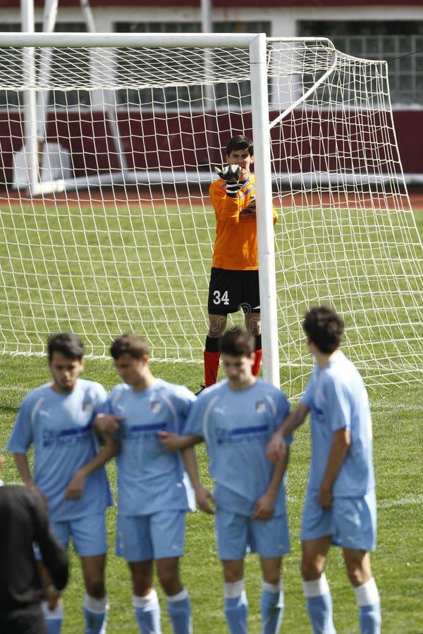 Football goalkeeper placing the wall for a free ki royalty free stock photo