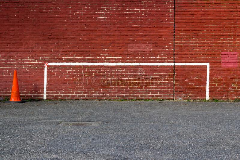 Football Goalposts, North London, England, UK - 20 March 2018 : Painted Goalpost Graffiti on Redbrick Wall with Orange Traffic Con royalty free stock photos