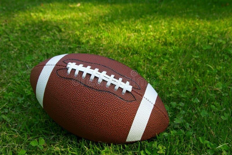 Football on grass stock photography