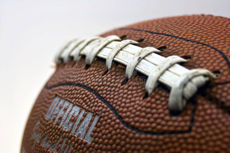 Football Grip. A diagonal view of the grip of a well used football stock image
