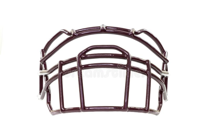 A football helmet`s facemask, isolated on white background, from below stock image