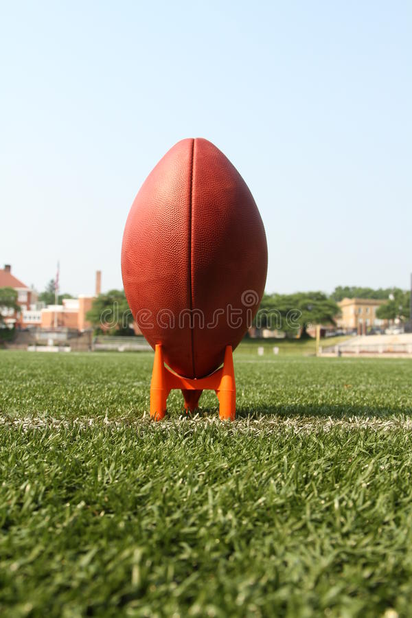 Football on a kicking tee royalty free stock images