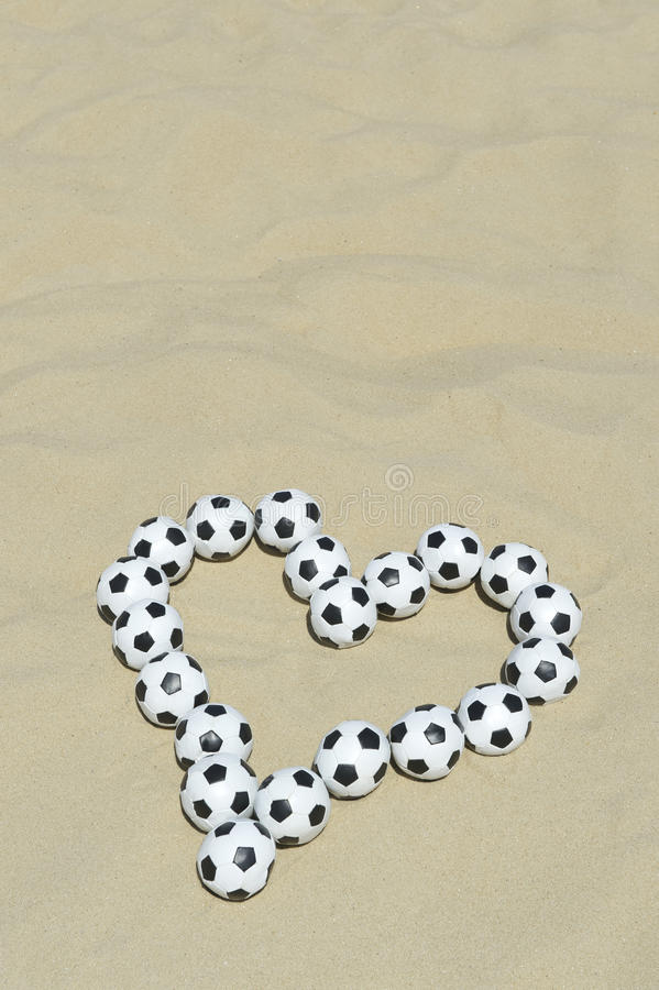 Football Love Heart Made with Soccer Balls on Beach. Football love heart made with soccer balls message on bright sand beach in Rio de Janeiro Brazil royalty free stock photos