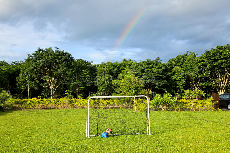 Football outdoors in yard after rain stock photos