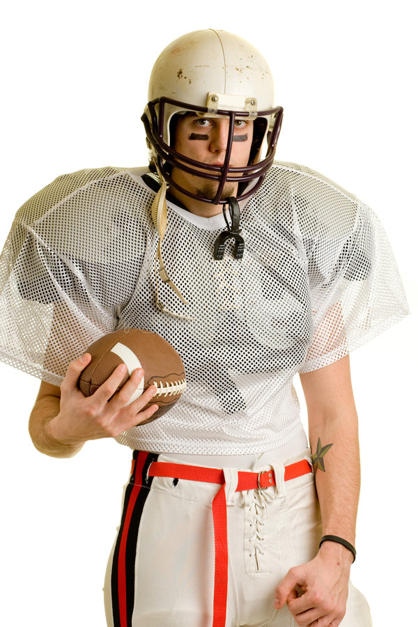 Football Player. American football player. Standing with helmet and ball royalty free stock photography