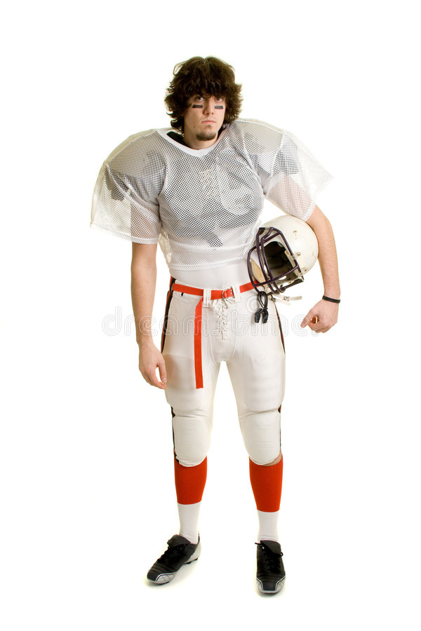 Football Player. American football player. Standing with helmet stock photos