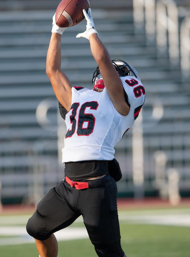 Football player in action during a game in South Texas stock images