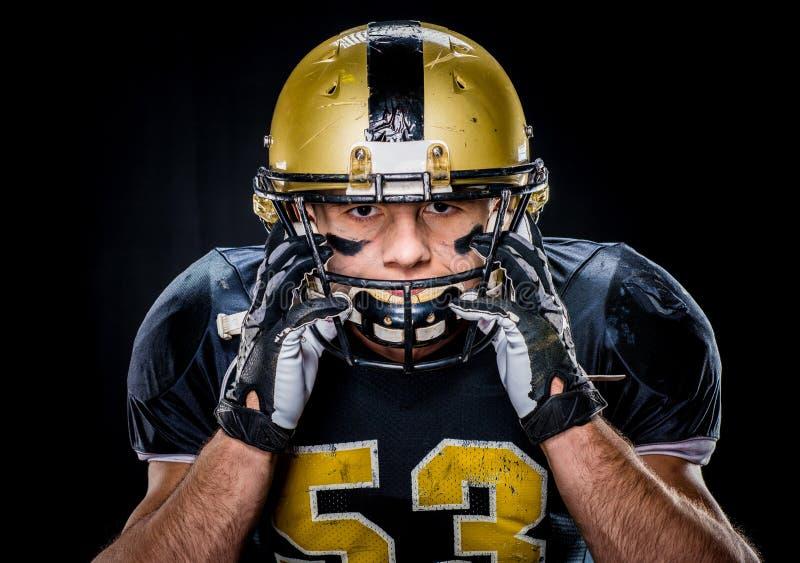 Football player adjusting helmet stock image