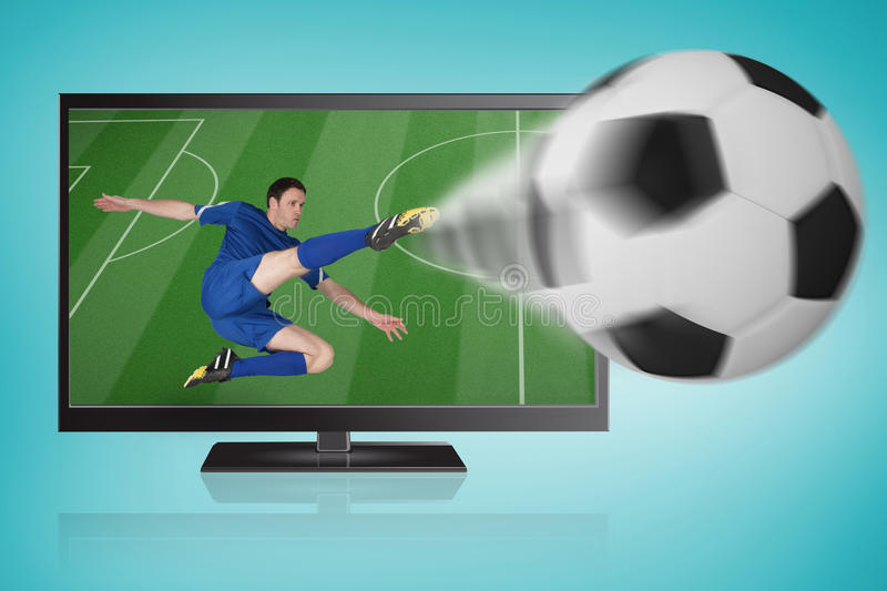 Football player in blue kicking ball out of tv stock photography
