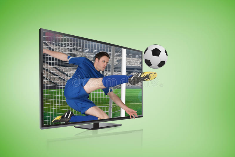 Football player in blue kicking ball through tv screen royalty free stock image