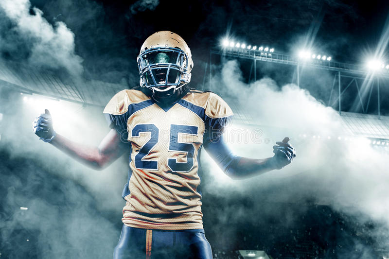Football player celebrates after scoring a touchdown. royalty free stock images